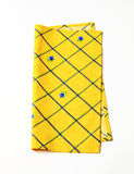 Yellow placemat. Small yellow place mat with flower pattern Stock Photography