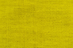 Yellow plain frabic close-up Stock Images