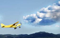 Yellow plane. Doing fly the plane from Aeromodelling stock image