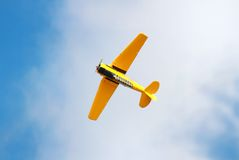 Yellow plane in the sky Royalty Free Stock Photos