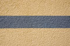 Yellow plaster with a grey stripe Royalty Free Stock Images