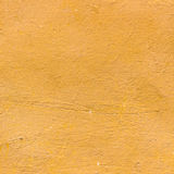 Yellow plaster seamless texture for background Royalty Free Stock Photos