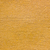 Yellow plaster seamless texture for background Stock Image