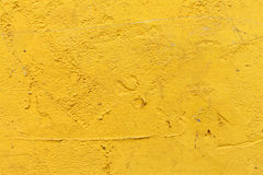 Yellow plaster wall Stock Photography