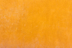Yellow plastered wall. In solid color Stock Image