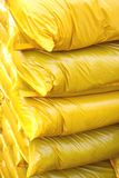 Yellow plastic bags Stock Photos