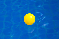 Yellow plastic ball in pool , pool villa house Royalty Free Stock Photography