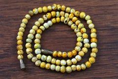Yellow plastic beads Stock Photo