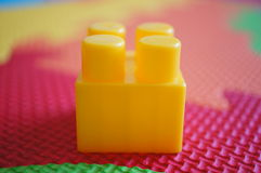 Yellow plastic block Stock Photography