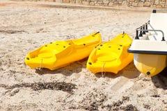 Yellow plastic boats Stock Photo