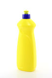 Yellow Plastic Bottle. A yellow dishsoap bottle against a white background Royalty Free Stock Photography