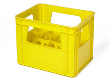 Yellow plastic case for bottles isolated on white Stock Image