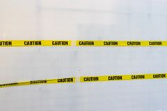 Yellow Plastic Caution Tape. Crossed Isolated on White Background royalty free stock photo