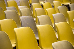 Yellow plastic chairs Stock Photography