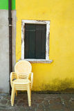 Yellow plastic chairs. Royalty Free Stock Image