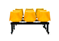 Yellow plastic chairs Royalty Free Stock Photos