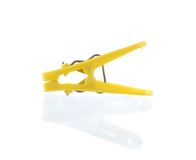 Yellow plastic cloth peg and reflection Royalty Free Stock Photography