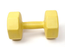 Yellow plastic coated dumbell Stock Photos