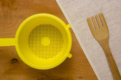 Yellow plastic colander Royalty Free Stock Images