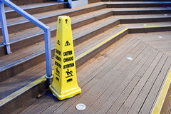 A yellow plastic cone warning Stock Photo