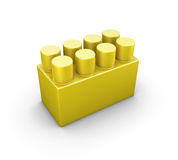 Yellow plastic construction element of the children designer Royalty Free Stock Images