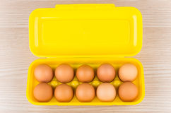 Yellow plastic container with chicken eggs Royalty Free Stock Images