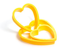 Yellow plastic cookies cutter Royalty Free Stock Photo