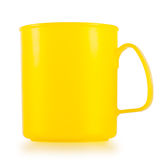 Yellow plastic cup. On white background royalty free stock photography