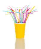 In a yellow plastic Cup colorful cocktail stick isolated Stock Photo