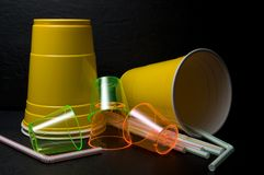 Yellow Plastic Cup, Plastic Shooter Glasses and Straws for Recycling. Horizontal royalty free stock images