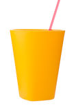 Yellow plastic cup with straw isolated on white. 