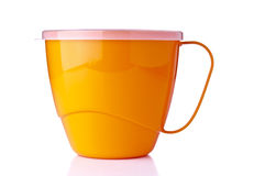 Yellow plastic cup Stock Photos