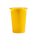 Yellow plastic cup, on white background Royalty Free Stock Photos