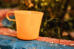 Yellow plastic cup. To drink water, coffee, tea, outdoors stock photography