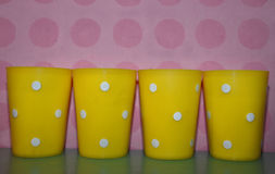 Yellow plastic cups Royalty Free Stock Photography