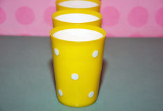 Yellow plastic cups Royalty Free Stock Photos