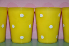 Yellow plastic cups Royalty Free Stock Images