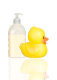 Yellow plastic duck and boat bath dispenser isolat Royalty Free Stock Photos