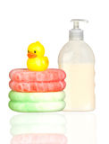 Yellow plastic duck over sponges and boat bath dis Stock Images