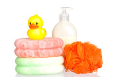 Yellow plastic duck over sponges and boat bath dis Royalty Free Stock Photos
