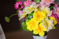 Yellow plastic flower in the vase. Royalty Free Stock Photos