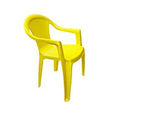 Yellow plastic garden chair Stock Images