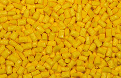Yellow plastic granulate pellets Royalty Free Stock Image
