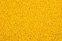 Yellow plastic granulate pellets Stock Image