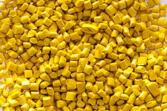 Yellow plastic granules Royalty Free Stock Image