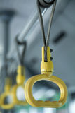 Yellow plastic handles Royalty Free Stock Image