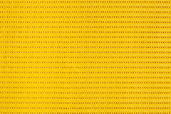 Yellow plastic holey background Stock Photo