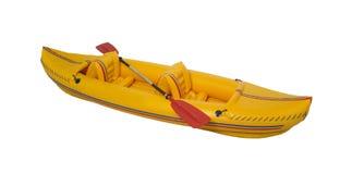 Yellow plastic kayak with paddle. Royalty Free Stock Image