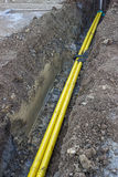 Yellow plastic line in the trench Royalty Free Stock Images