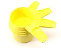 Yellow plastic measuring cups Stock Photo